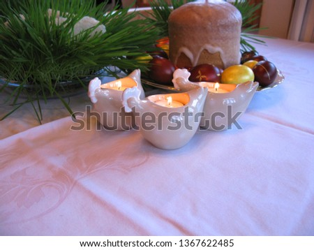 Easter symbols - Ester cake and eggs with oak grass and porcelain  figures of chicken. #1367622485