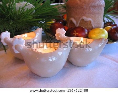 Easter symbols - Ester cake and eggs with oak grass and porcelain  figures of chicken. #1367622488