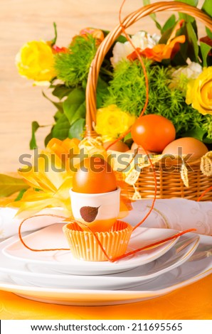 Easter table decoration in orange colours