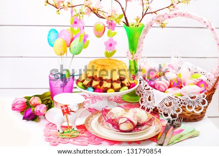 easter table decoration with marble ring cake and eggs in wicker basket
