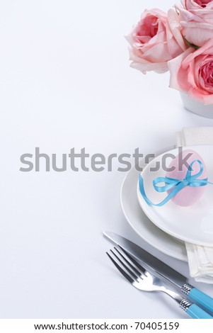 Easter table setting with flowers and easter egg