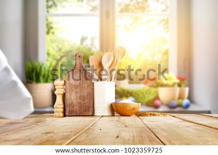 Easter table with spring flowers in a sunny April kitchen