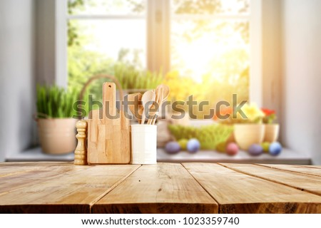 Photo of Easter table with spring flowers in a sunny April kitchen