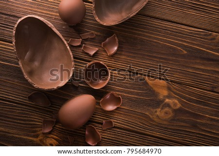 easter tasty chocolate egg on a wooden table. holiday candy dessert. top view #795684970