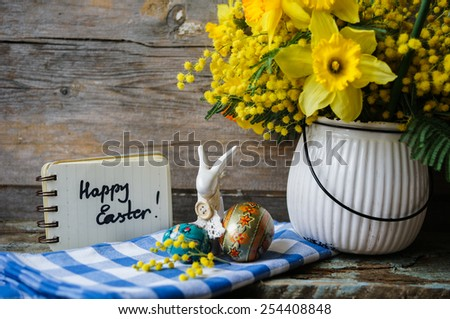 Easter time, spring flowers, easter eggs and  easter bunny