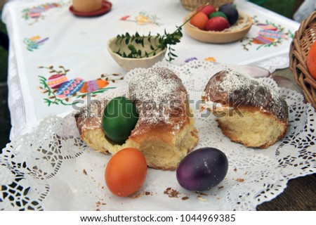 Easter traditions - colorful eggs placed in a traditional sweet bread. #1044969385