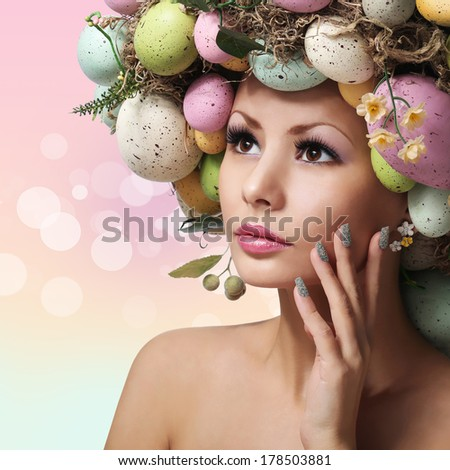 Easter Woman. Spring Girl with Fashion Hairstyle. Portrait of Beautiful Model with Colorful Eggs. Pastel Colors.