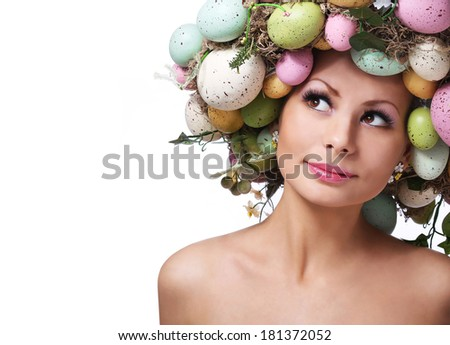 Easter Woman. Spring Smiley Girl with Fashion Hairstyle. Portrait of Beautiful Model with Colorful Eggs.
