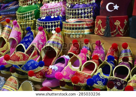 Eastern bazaar - handmade shoes. Image of selling point at Istanbul market with large selection of traditional arabic handmade ornate shoes