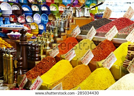 Eastern bazaar - spices, coffee Turks and hand mills. Image market Istanbul large colorful oriental selection of spices on foreground coffee Turks and mills on background with focus on Turks