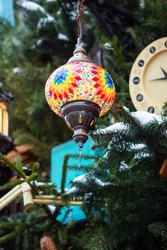 Eastern bright lamps. Colored glass mosaic lights Christmas decorations of the city. Decorative art of the East