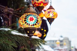 Eastern bright lamps. Colored glass mosaic lights Christmas decorations of the city. Decorative art of the East copy space
