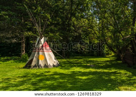 Eastern Canadian Common Tipi featuring vivid yellow,red and taupe colors #1269818329