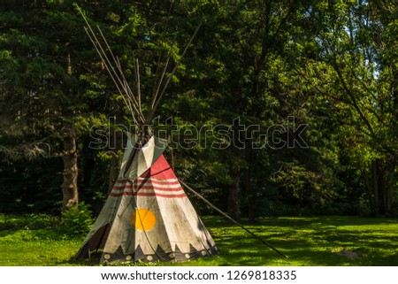 Eastern Canadian Common Tipi featuring vivid yellow,red and taupe colors #1269818335