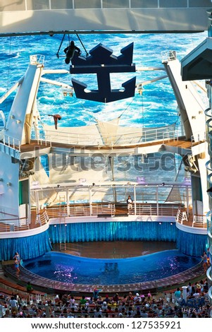 EASTERN CARIBBEAN - JAN. 17: Royal Caribbean's Oasis of the Seas pool (the deepest at sea) is an amphitheater, hosting a diving show where divers jump from as high as 72 ft, on Jan.17, 2013.