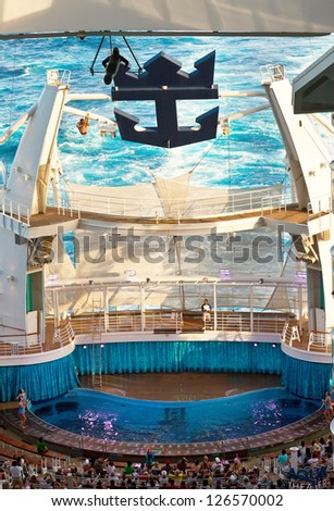 EASTERN CARIBBEAN - JAN. 17:  Royal Caribbean's Oasis of the Seas pool (the deepest at sea) is by night an amphitheater, hosting a diving show where divers jump from as high as 72 ft, on Jan.17, 2013.