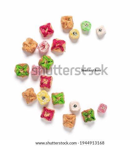 Eastern dessert baklava and Turkish delight in the shape of a crescent moon isolated on a white background. Creative layout. Ramadan. Top view Stock photo ©