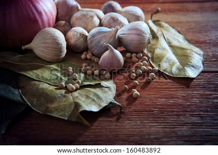 eastern food style dry spice herb garlic red onion white pepper dry leaves  on wood table