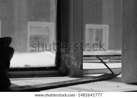 Eastern incense smoldering on the windowsill in the yoga room