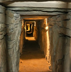 Eastern passage of Knowth Megalithic Tomb, build 3200 BC is 40 metres, making it the longest megalithic passage in Western Europe, the passage ends in a cruciform chamber with a corbelled roof.