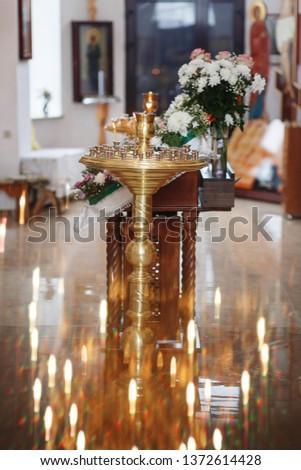 Eastern Russian Orthodox Church interior, church candles, church icons #1372614428