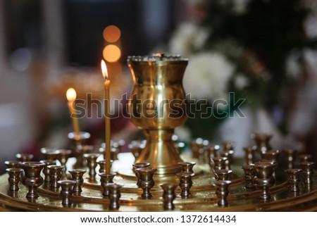 Eastern Russian Orthodox Church interior, church candles, church icons #1372614434
