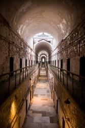Eastern State Penitentiary - Long Worn-Down Jail Cell Corridor in Historic Landmark of Philadelphia, Pennsylvania