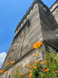 Eastern State penitentiary walls with gorgeous flowers
