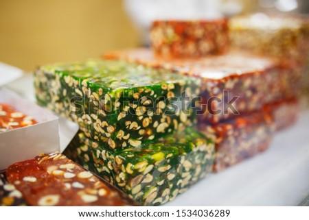 Eastern sweets, confectionery on the counter, Sherbet, Dzhezerye, halva, Turkish delight baklava.