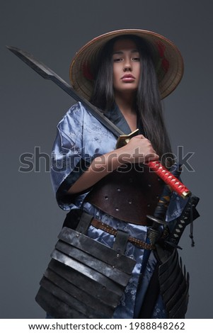 Eastern woman warrior with samurai sword and kasa Zdjęcia stock ©