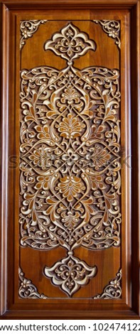 Eastern wooden carvings with beautiful patterns.Handmade on the door. #1024741222