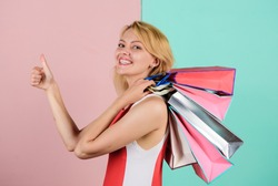 Easy and fast. summer discount. special offer on black friday. shop closeout. happy woman shopper. big sale. female shopaholic hold shopping bags. present packages for holiday preparation.