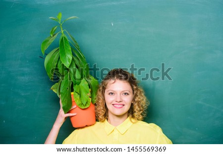 Easy houseplants. Houseplants benefits and positive influence on health. Take good care houseplants. Girl hold plant in pot. Floral shop. Botany is about plants flowers and herbs. Home garden. #1455569369