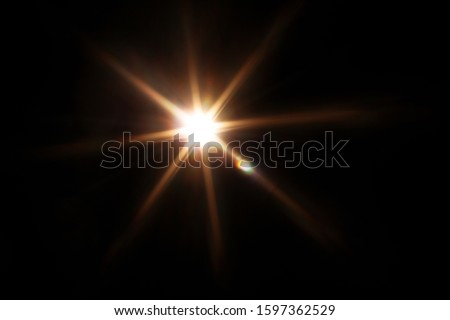Easy to add lens flare effects for overlay designs or screen blending mode to make high-quality images. Abstract sun burst, digital flare, iridescent glare over black background. Сток-фото ©