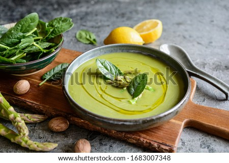 Easy to make creamy asparagus and spinach soup in a ceramic plate Stock photo ©