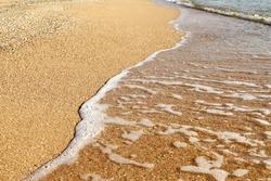 easy wave on sand beach