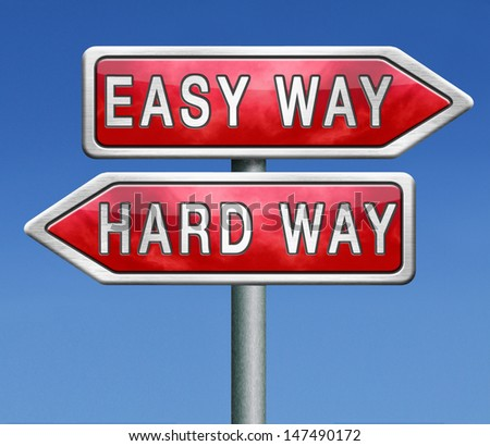 easy way and hard way roadsign arrow on blue background crossroads decisive choice challenge making choice stand out from crowd taking risk adventure character test