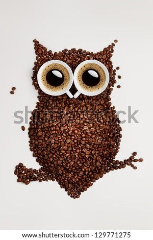 Easy way to the nightlife. A funny owl, made of coffee seeds and two caps on grey background.