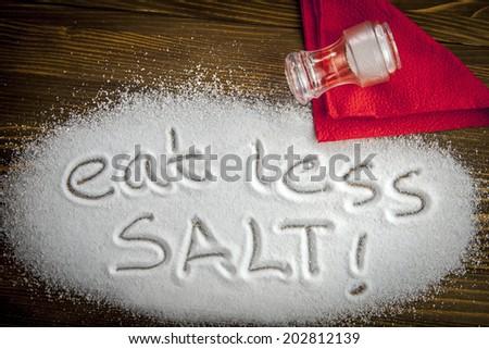 Eat less salt written on a heap of salt - anti-hypertensive campaign