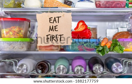 Eat Me First handmade sign in fridge, eat food first area to help reduce food waste, know where to look first, simple reduce food waste concept. Stok fotoğraf ©