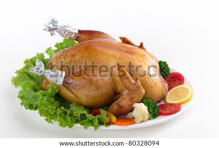 Eatable whole grilled chicken served with vegetable - stock photo