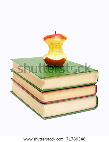 eaten apple on a stack of books