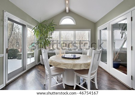 Eating area in suburban home with doors to patio
