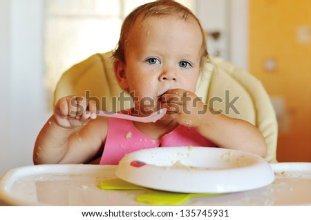 eating baby girl with dirty face