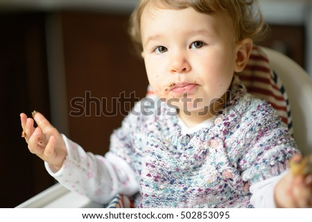 Detail · Eating Baby Girl With Messy Face. The Nice One Year Child Eats And  Looking