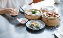 eating breakfast Cantonese cuisine dim sum using chopsticks