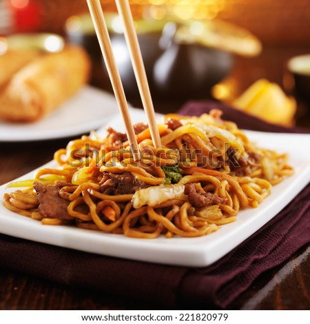 eating chinese beef lo mein with chopsticks ストックフォト ©