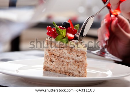 Eating fresh Esterhazy cake with berries