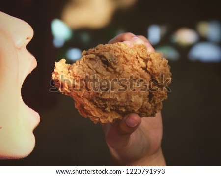 eating fried chicken #1220791993