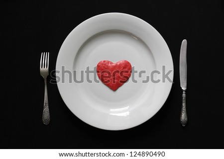 Eating of the human heart by the silverware tools